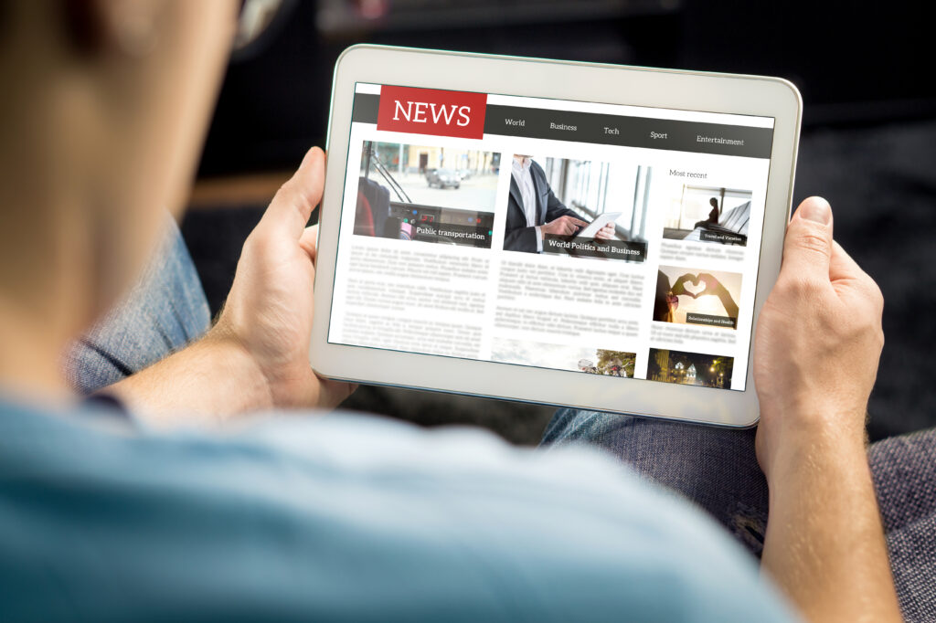 Online,News,Article,On,Tablet,Screen.,Electronic,Newspaper,Or,Magazine.