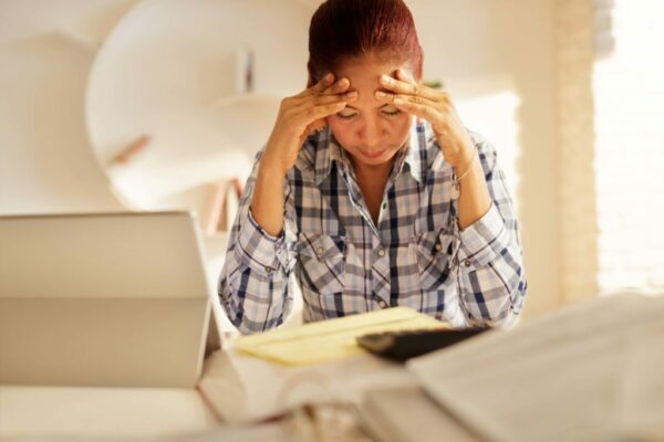 Angry Senior Woman Paying Bills And Filing Federal Tax Return